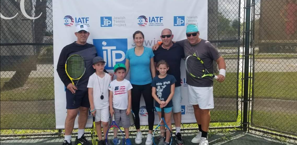 Israeli tennis pros Shahar Peer and Shlomo Glickstein with chairman Ian Halperin and founder Assaf Ingber at the Pro-AM event in Aventura, Fla. Credit: Jewish Tennis Project.