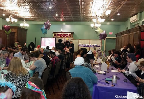 Guests hear the Megillah and enjoy the festivities at a past Purim party sponsored by Chabad-Lubavitch of Louisiana.