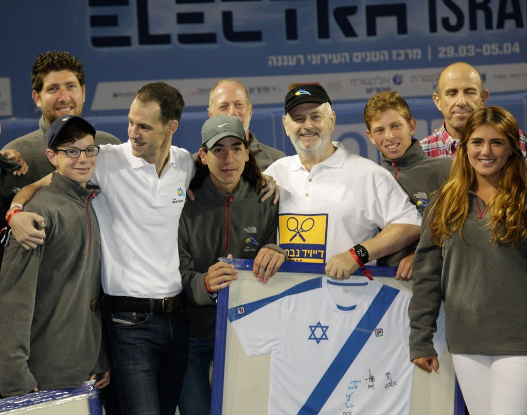 David Coffer, in black hat, at ceremony in Raanana honoring him and son Adam, third from left, for 10 years of service to Israeli tennis, April 2015. (Courtesy of the David Squad)