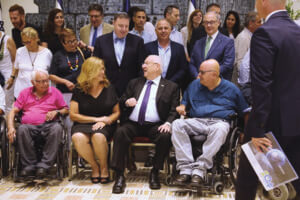 President Rivlin laughs with his guests