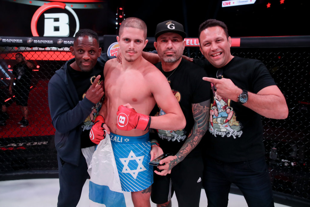 Israeli mixed martial-arts fighter Aviv Gozali with his training staff following a fight against Eduard Muravitskiy. Credit: Courtesy.