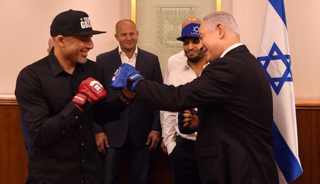 Israeli Prime Minister Benjamin Netanyahu takes a jab at mixed martial-arts fighter Haim Gozali. Credit: Courtesy.