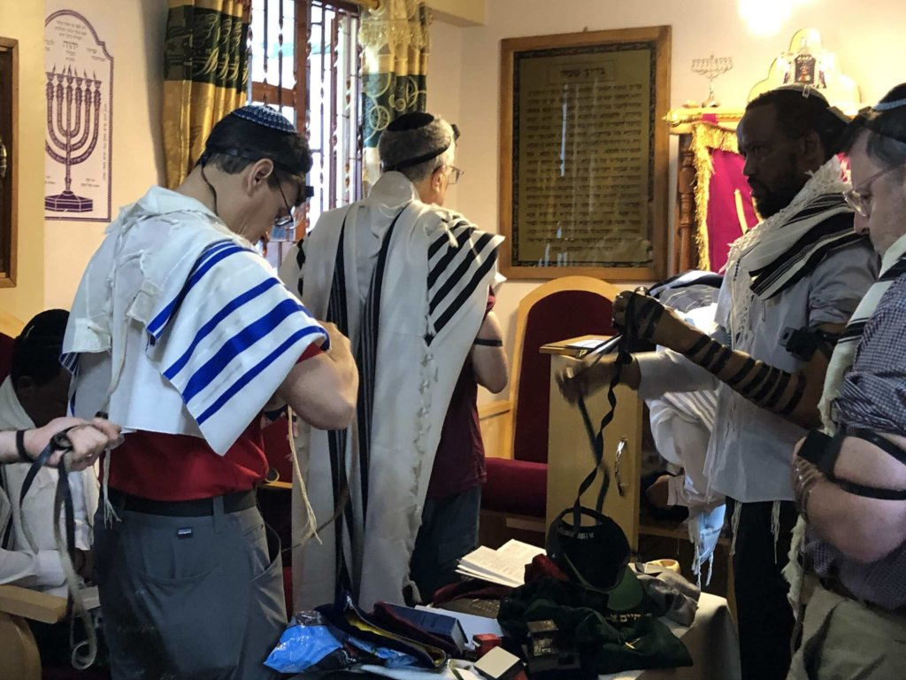 Group members praying with the small Arusha Jewish community of Tanzania. Credit: Friends of Access Israel.
