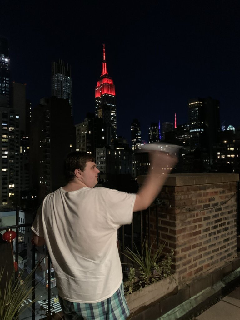 Max Wagenberg launching his paper airplane off his New York City terrace. Credit: Courtesy.